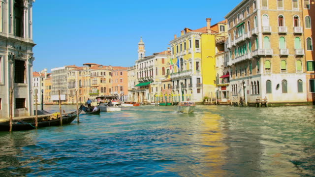 ms t/l view of hyper lapse of vaporetto (water taxi) ride along canal grande passing underneath rialto bridge / venice veneto italy - ferry ride stock videos & royalty-free footage