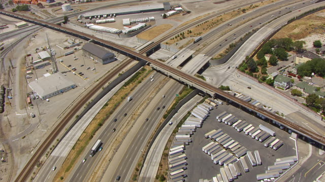 WS AERIAL POV View of I-880 freeway and MacArthur Maze overpass / Berkeley, California, United States