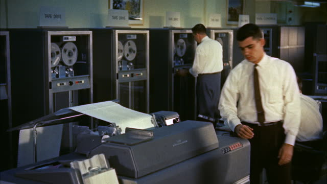 vídeos de stock e filmes b-roll de ms pan  view of  ibm machine room and  clerks / washington d.c. united states - 1950 1959
