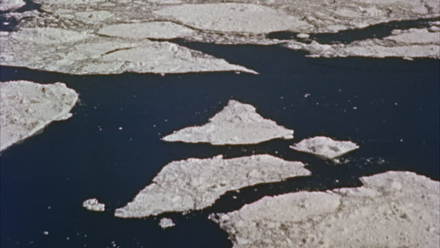aerial pov view  of ice sheet over water - ice sheet stock videos and b-roll footage