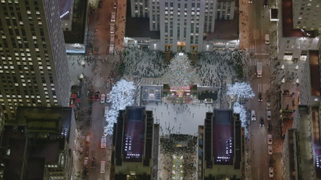 aerial ms zi view of ice skating at rink at rockefeller center / new york city  - ice skating stock videos & royalty-free footage