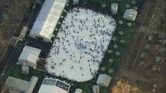ws zo aerial view of ice skating rink in new york city / new york city, new york, usa - bryant park stock videos and b-roll footage