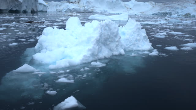 view of icebergs floating in inlet at disko bay - inlet stock videos & royalty-free footage