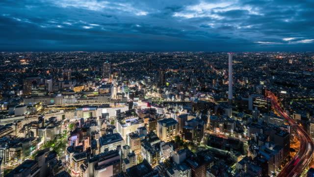 t/l ws ha 池袋ビュー夕暮れ夜への移行から/東京 - 昼から夜点の映像素材/bロール
