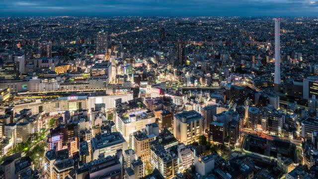 t/l ws ha pan view of ikebukuro dusk to night transition / tokyo, japan - dusk to night stock videos & royalty-free footage