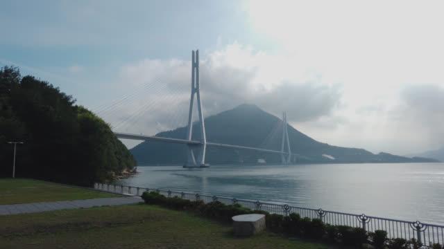 view of ikuchijima, hiroshima prefecture , japan in the morning - onomichi hiroshima stock videos and b-roll footage