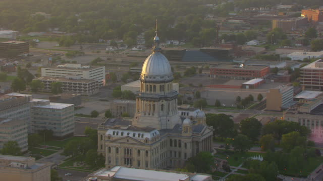 WS AERIAL POV View of Illinois State Capitol building with cityscape / Springfield, Illinois, United States