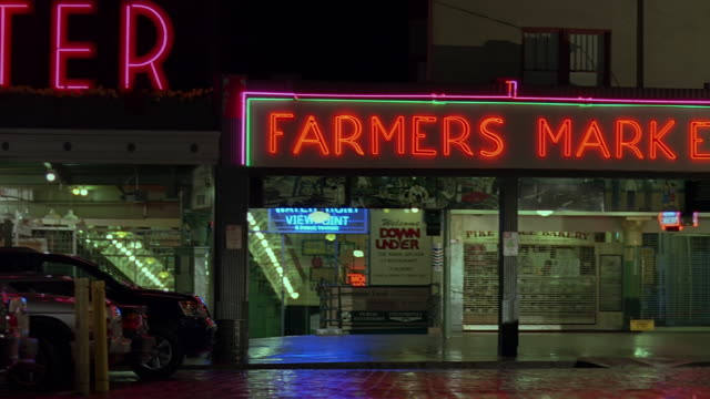 stockvideo's en b-roll-footage met ms tu view of illuminated text at farmer's market at night / seattle, washington, usa - informatiebord