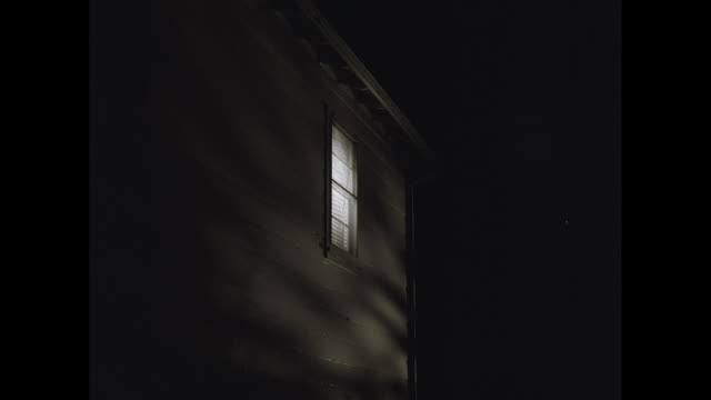ms view of illuminated window of house at night / united states - windows stock videos and b-roll footage