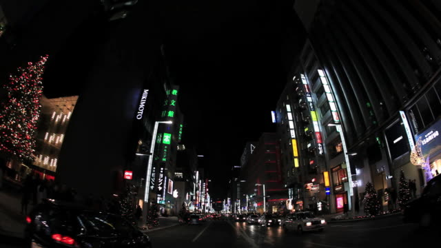 ms pov view of illumination city at night and moving traffic on road / ginza, tokyo, japan - traffic点の映像素材/bロール