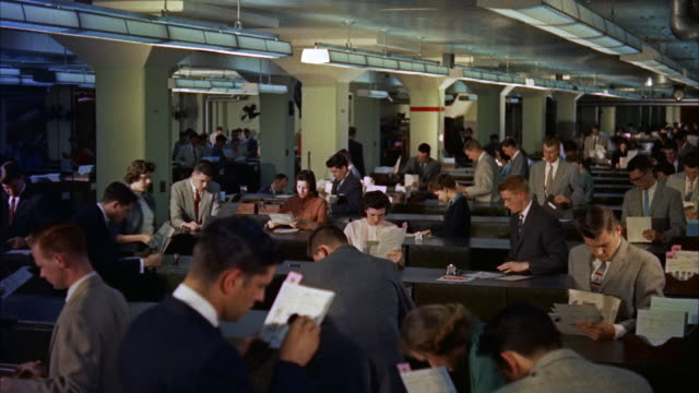 ms view of immense file room with many clerks / washinton d.c., united states - 1950 1959 bildbanksvideor och videomaterial från bakom kulisserna