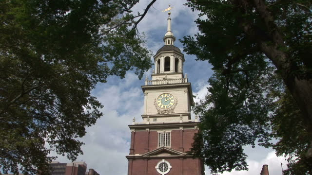 view of independence hall surrounded by trees in philadelphia united states - independence hall stock videos and b-roll footage