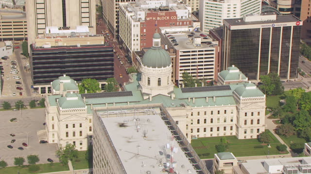 ws aerial pov view of indiana state capitol building with city / indianapolis, marion county, indiana, united states - indiana stock videos & royalty-free footage