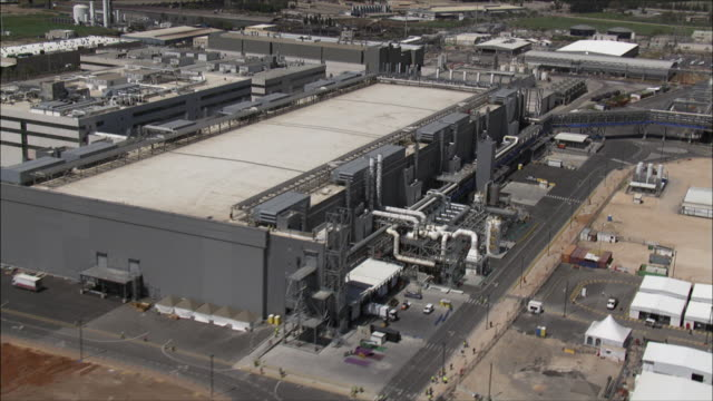 ws pov aerial view of industrial area in israel / negev, israel - industrial district stock videos & royalty-free footage