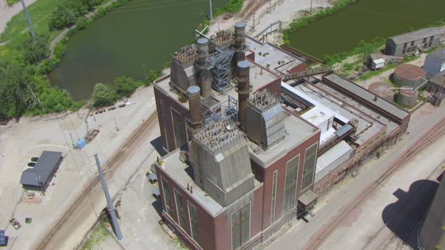 WS AERIAL POV View of industrial building / Cedar Rapids, Iowa, United States