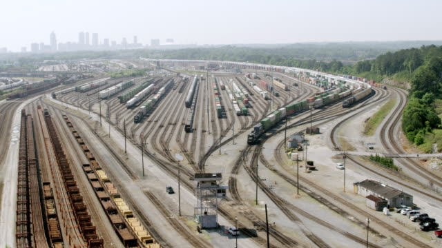 WS AERIAL POV View of Inman Yard with container train / Atlanta, Georgia, United States