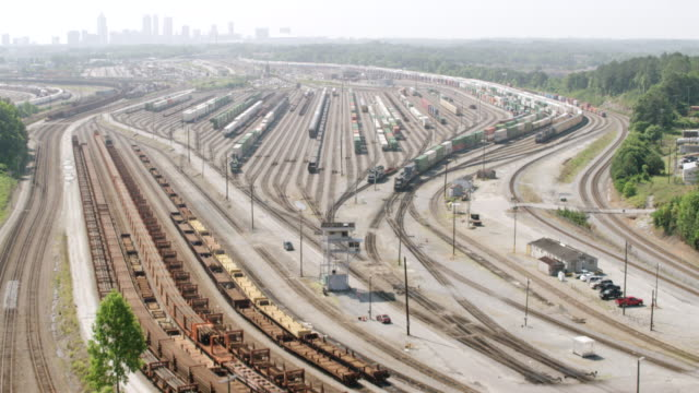 ws aerial pov view of inman yard with container train / atlanta, georgia, united states - shunting yard stock videos and b-roll footage