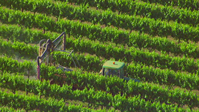 ws aerial zo zi view of insecticide spraying in field / new south wales, australia - crop sprayer stock videos and b-roll footage