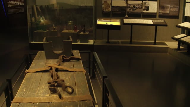 a view of instruments of torture in the exhibition hall of crime evidence of japanese germ factory on may 19 2017 in harbin china this japanese germ... - instrument of torture stock videos & royalty-free footage