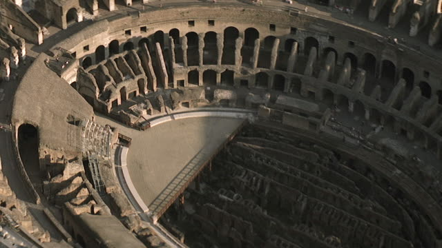 ws aerial ds zo view of interior of coliseum / rome, italy - colosseo video stock e b–roll