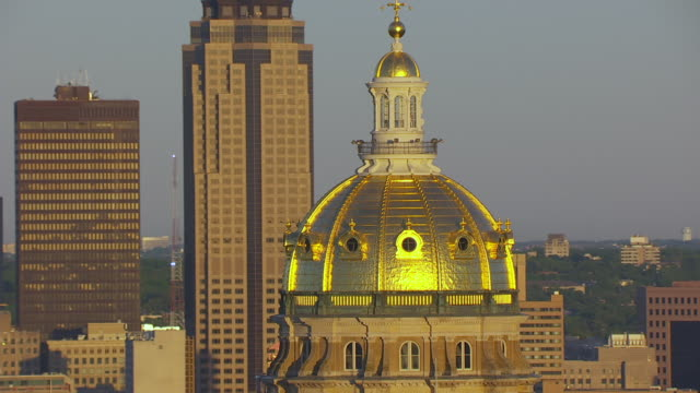 WS TU AERIAL POV View of Iowa State Capitol and 801 Grand building at sunrise / Des Moines, Iowa, United States