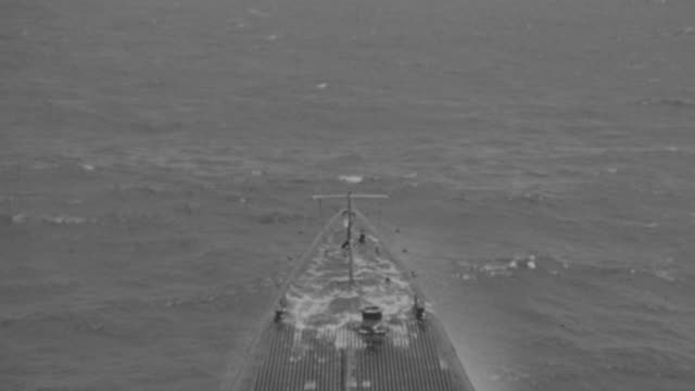 WS POV View of iron fence of bombing boat going on river