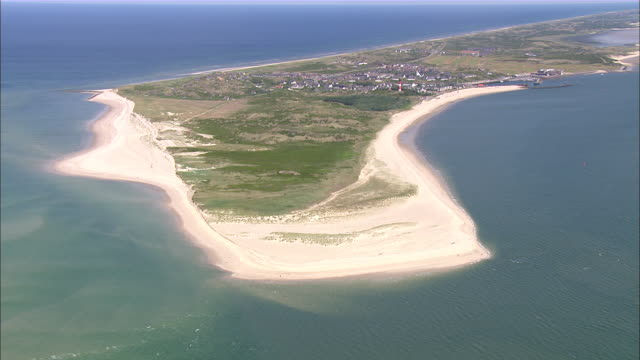 ws aerial view of is land surrounded by sea / sylt, schleswig-holstein, germany - sylt stock videos & royalty-free footage