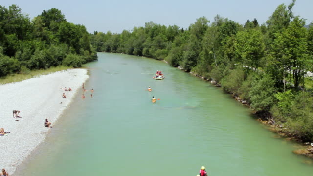 MS View of Isar river with various canoes and inflatable rafting boats on river / Lenggries, Bavaria, Germany