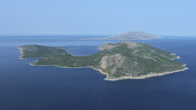 WS AERIAL View of island and small fisher boat / Dodecanese, Greece