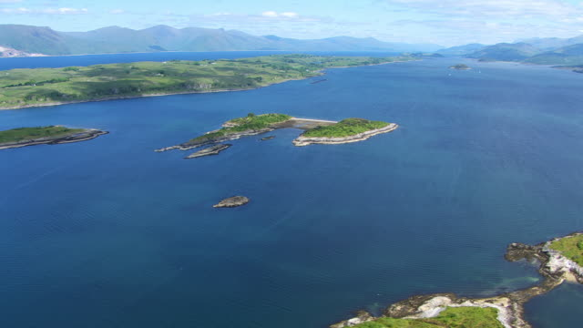 WS AERIAL TU View of island of Lismore in Hebrides and Lynn of Lorn / Isle or island of Lismore, Argyll and Bute, Scotland