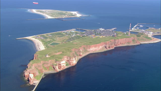 aerial ws view of island surrounded by ocean / heligoland, schleswig-holstein, germany - helgoland stock videos & royalty-free footage