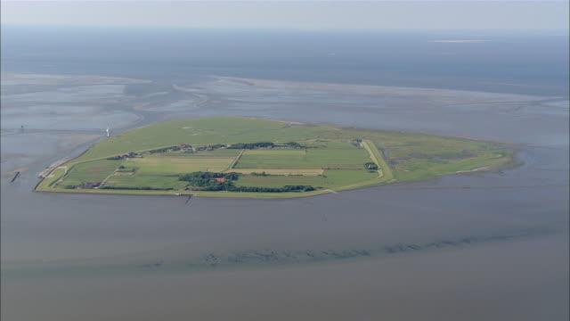 AERIAL WS View of island surrounded by ocean / Neuwerk, Schleswig-Holstein, Germany