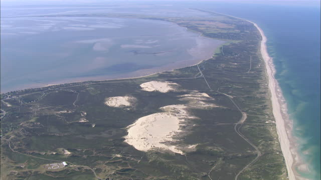 ws aerial view of island surrounded by sea / sylt, schleswig-holstein, germany - north sea stock videos & royalty-free footage