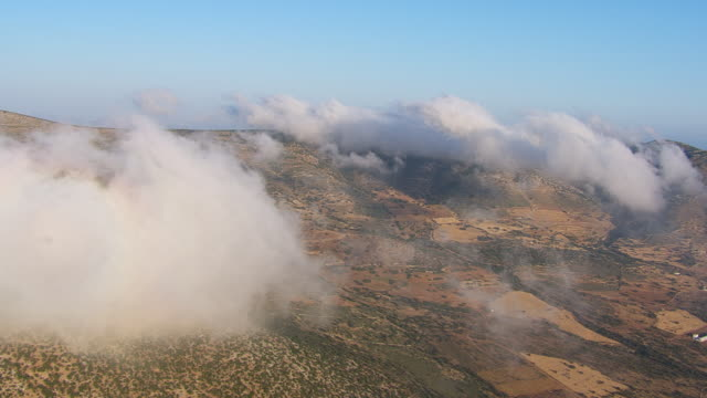WS AERIAL View of island with clouds / Naxos, Cyclades, Greece