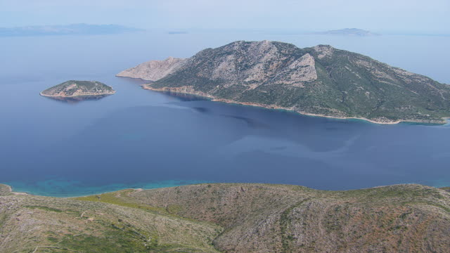 ws aerial view of island with open water sea / amorgos, cyclades, greece - greek islands stock videos and b-roll footage