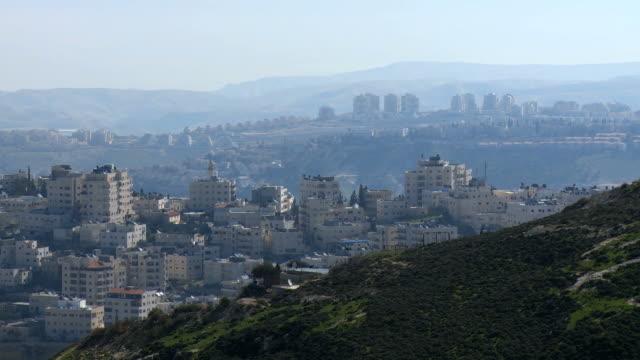 WS View of Israeli settlement maale adumim and Arab village AlZaim / Jerusalem, Judea, Israel