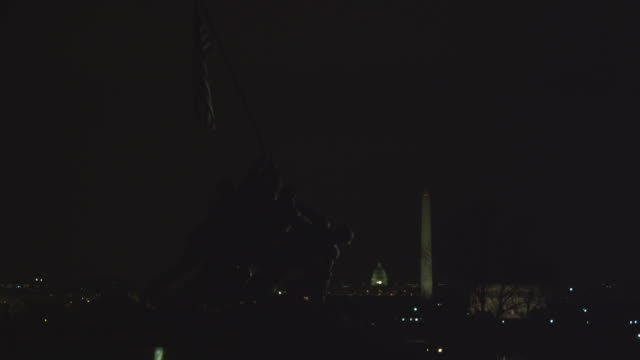 ws view of iwo jima memorial framing us capitol and washington monument at night / washington, district of columbia, united states - arlington virginia stock videos & royalty-free footage