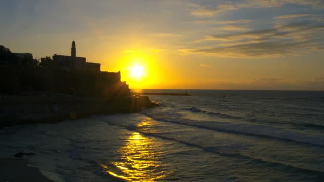 ws pan view of jaffa sea port at sunset time / tel aviv, dan metropolitan, israel - jaffa stock videos & royalty-free footage