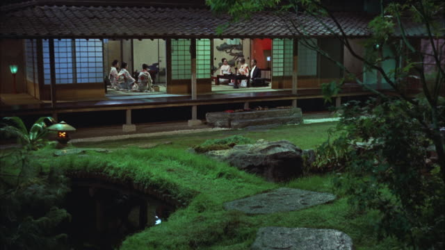ms view of japanese garden dining group in open side house  - oriental garden stock videos and b-roll footage