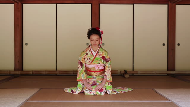 ws view of japanese woman with kimono bowing, japanese style sitting on tatami floor / yamaguchi, yamaguchi prefecture, japan  - social grace stock videos & royalty-free footage