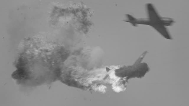 WS View of Japanese zero in flight FTC plane explodes and goes down in flames (miniature)