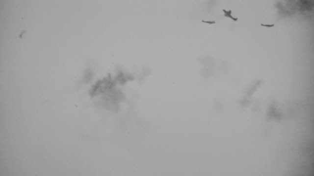 WS View of Japanese zero planes under attacking, lots of flak in air around planes