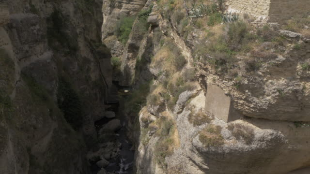 View of Jardines De Cuenca and El Tajo Gorge from Puente Viejo, Ronda, Andalucia, Spain, Europe