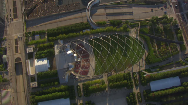 WS AERIAL POV View of Jay Pritzker Pavilion and Cloud Gate in Millennium Park / Chicago, Cook County, Illinois, United States
