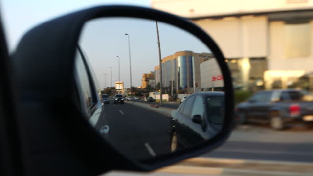 view of jeddah traffic in the side mirror of a car - mirror stock videos & royalty-free footage