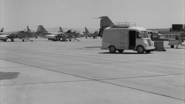 stockvideo's en b-roll-footage met ws view of jet airplanes park at airfield  - luchtmacht
