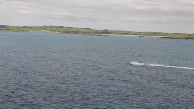 ws view of jet skis on water / dublin, ireland - jet boating stock videos & royalty-free footage