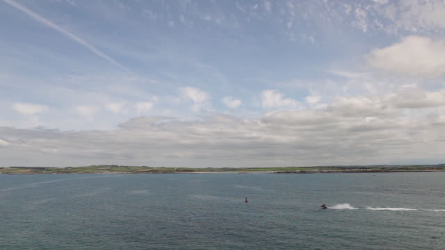 ws pan view of jet skis on water / dublin, ireland - jet boating stock videos & royalty-free footage