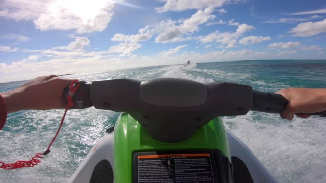 pov view of jetski personal watercraft in moorea tropical island. - moorea stock videos & royalty-free footage