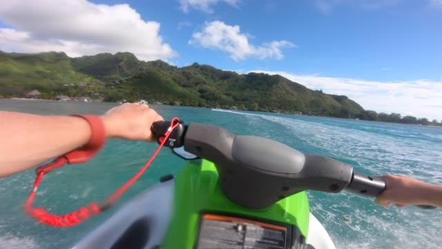 pov view of jetski personal watercraft in moorea tropical island. - jet ski stock videos & royalty-free footage